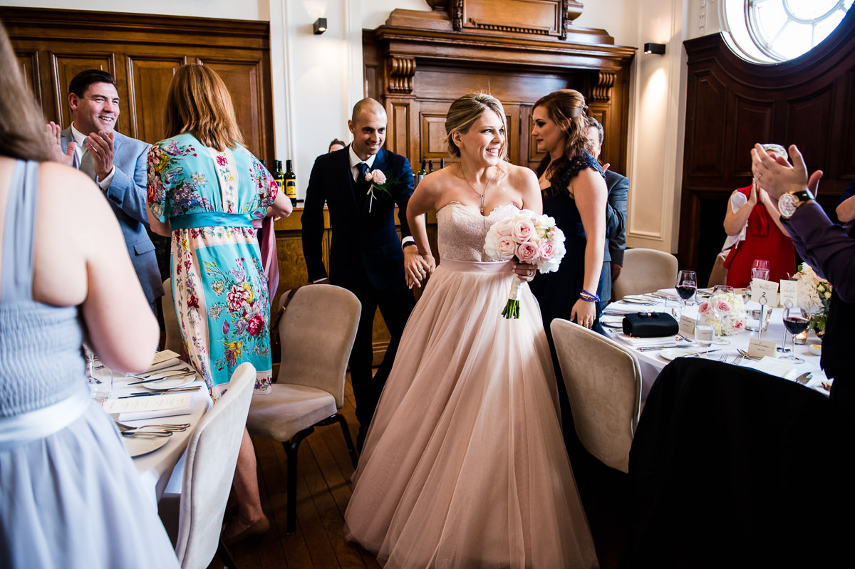 bride and groom enter wedding breakfast in town hall hotel