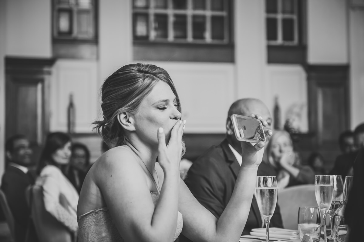 bride blowing a kiss to a wedding guest at town hall hotel