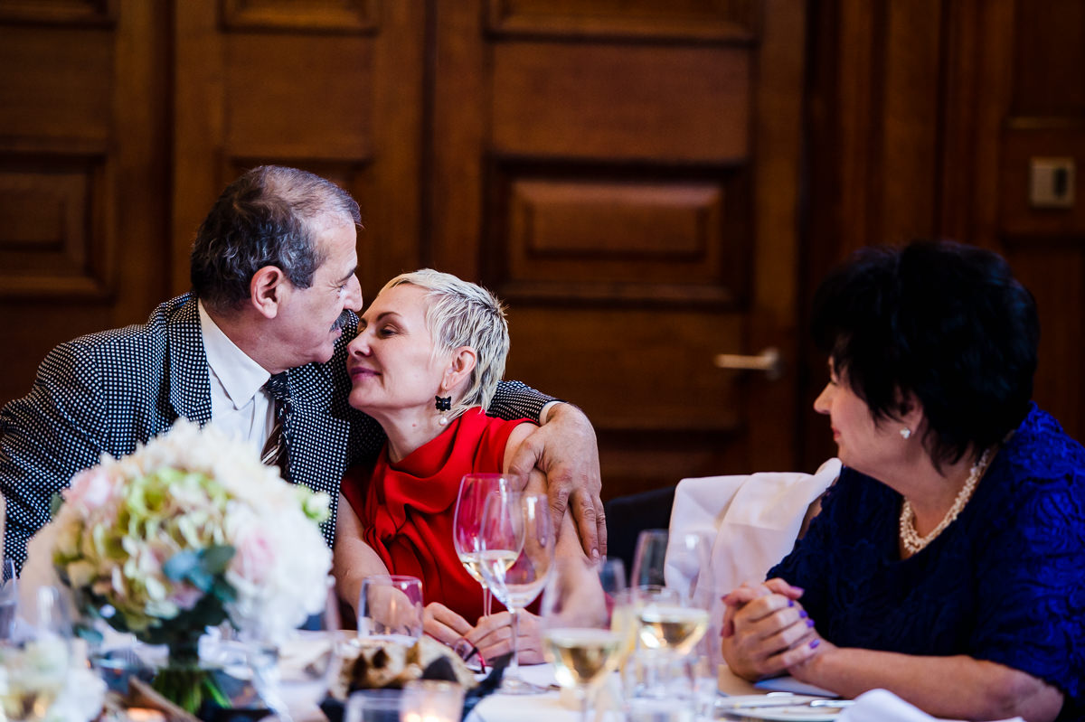 Guests kissing at a town hall hotel wedding