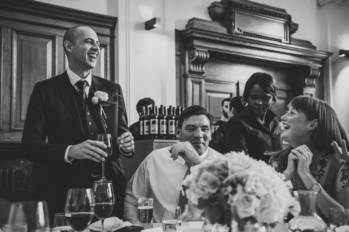 Groom and guests laughing at wedding at town hall hotel