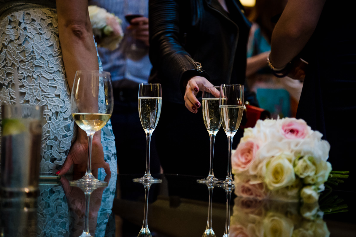 Town Hall Hotel wedding glasses of champagne and brides bouquet