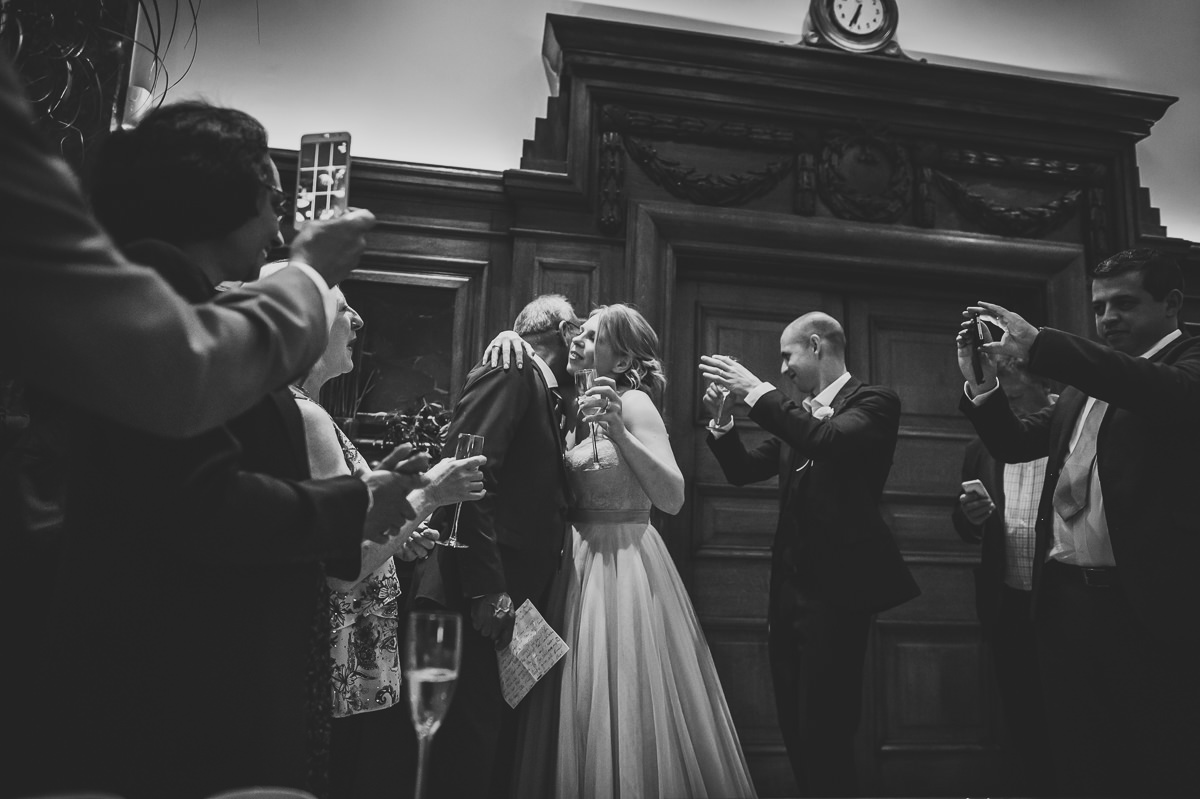 Bride kissing father in law after speech