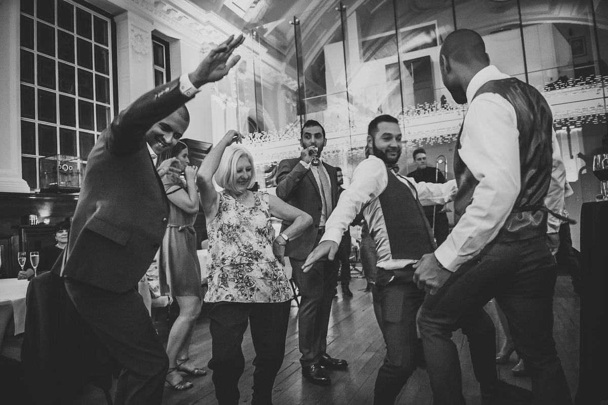 Wedding guests dancing at party