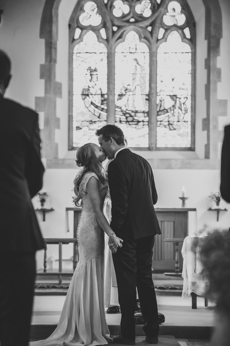 newly weds kissing as they are announced man and wife