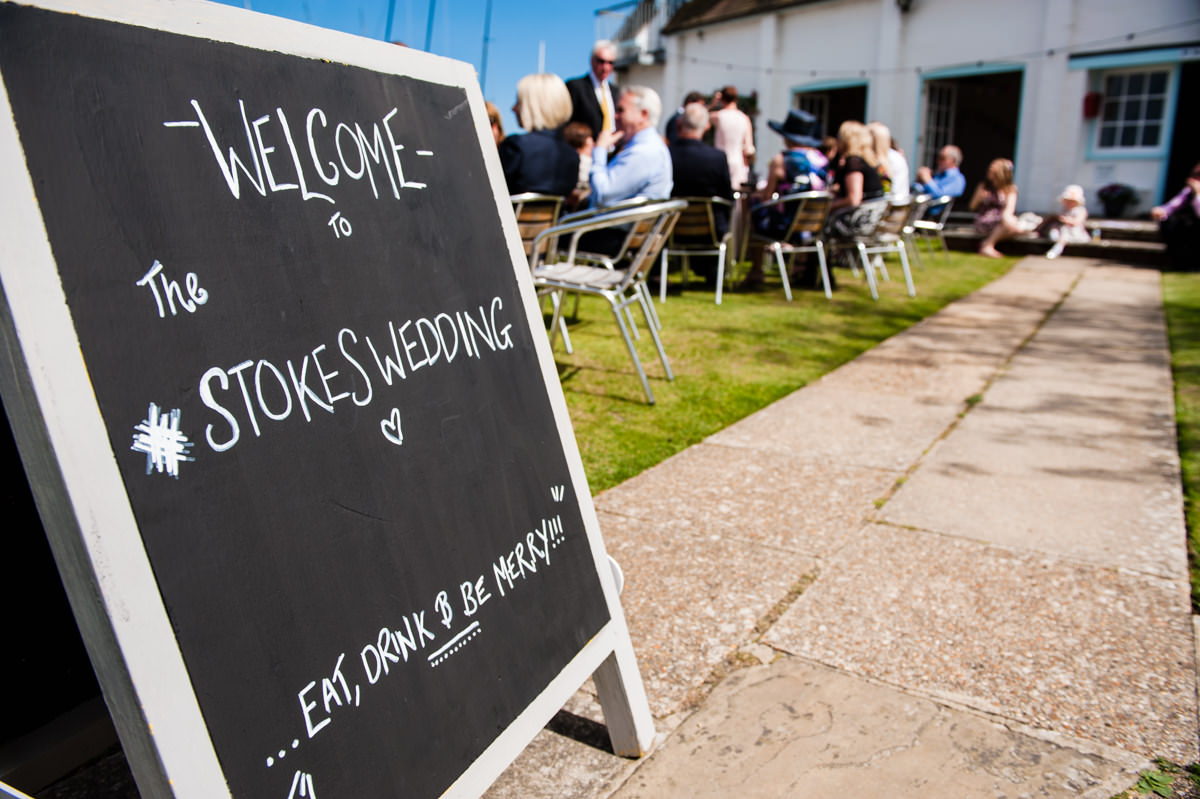 Welcome sign at a wedding at Itchenor Sailing Club