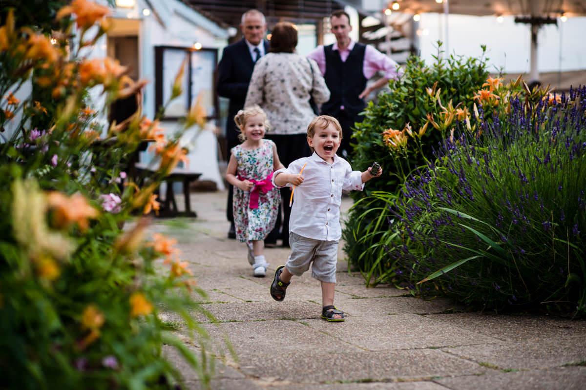 Happy children running around at the Itchenor Sailing Club