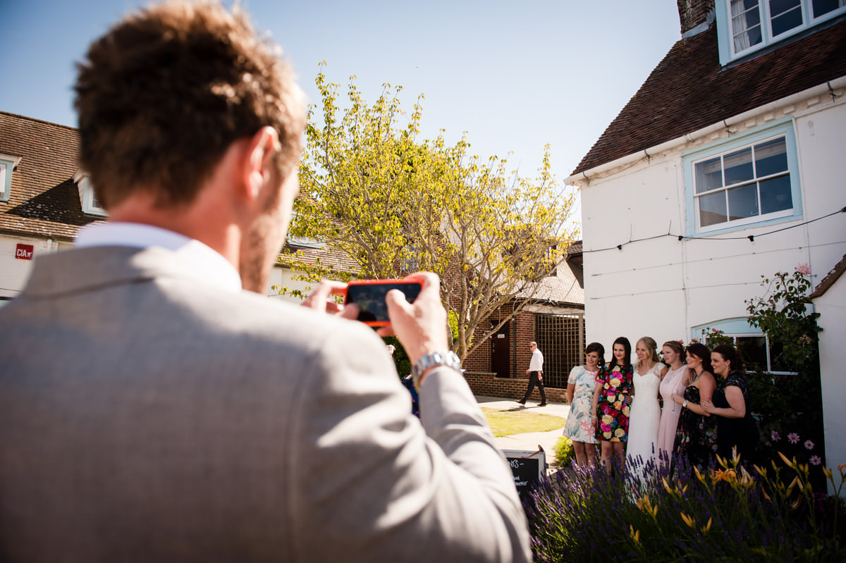 Photos being taken of guests at a wedding