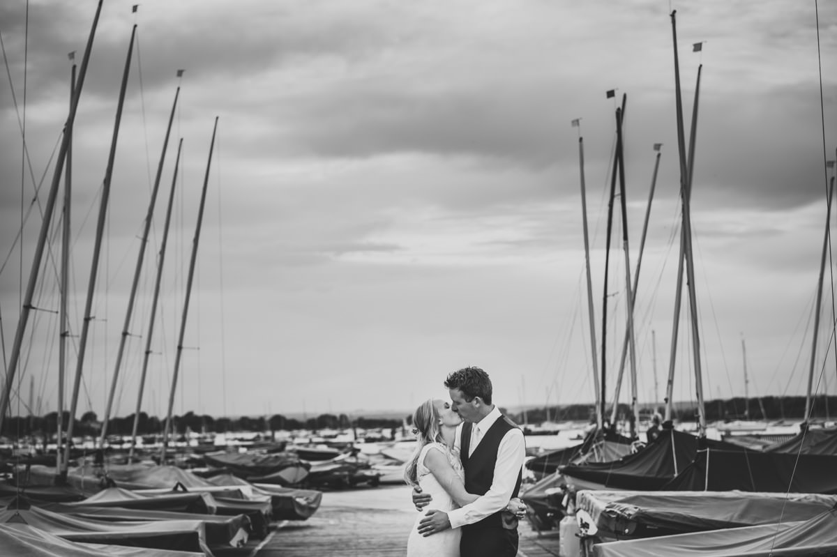 Bride and Groom kissing at their Itchenor Sailing Club wedding