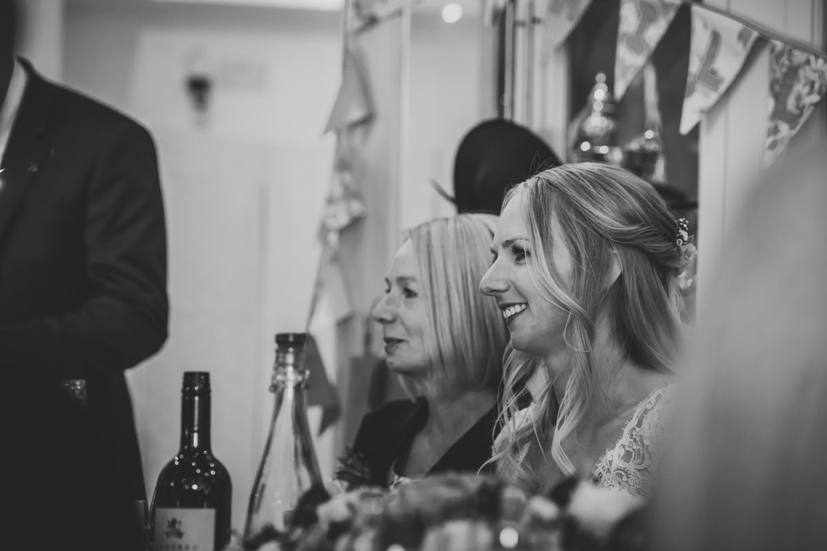 Bride listening to wedding speech from her Dad at Itchenor Sailing Club