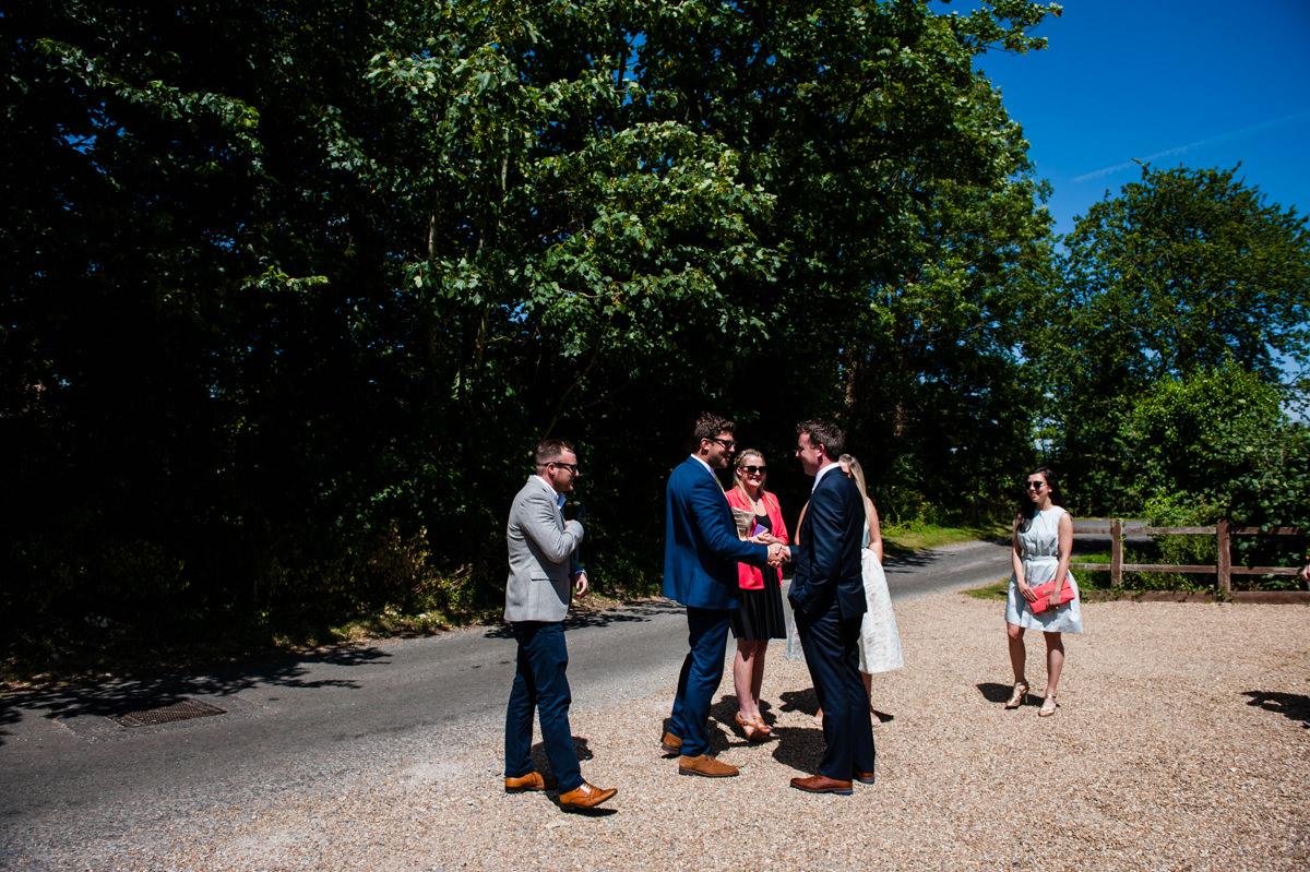 groom greeting guests before his wedding