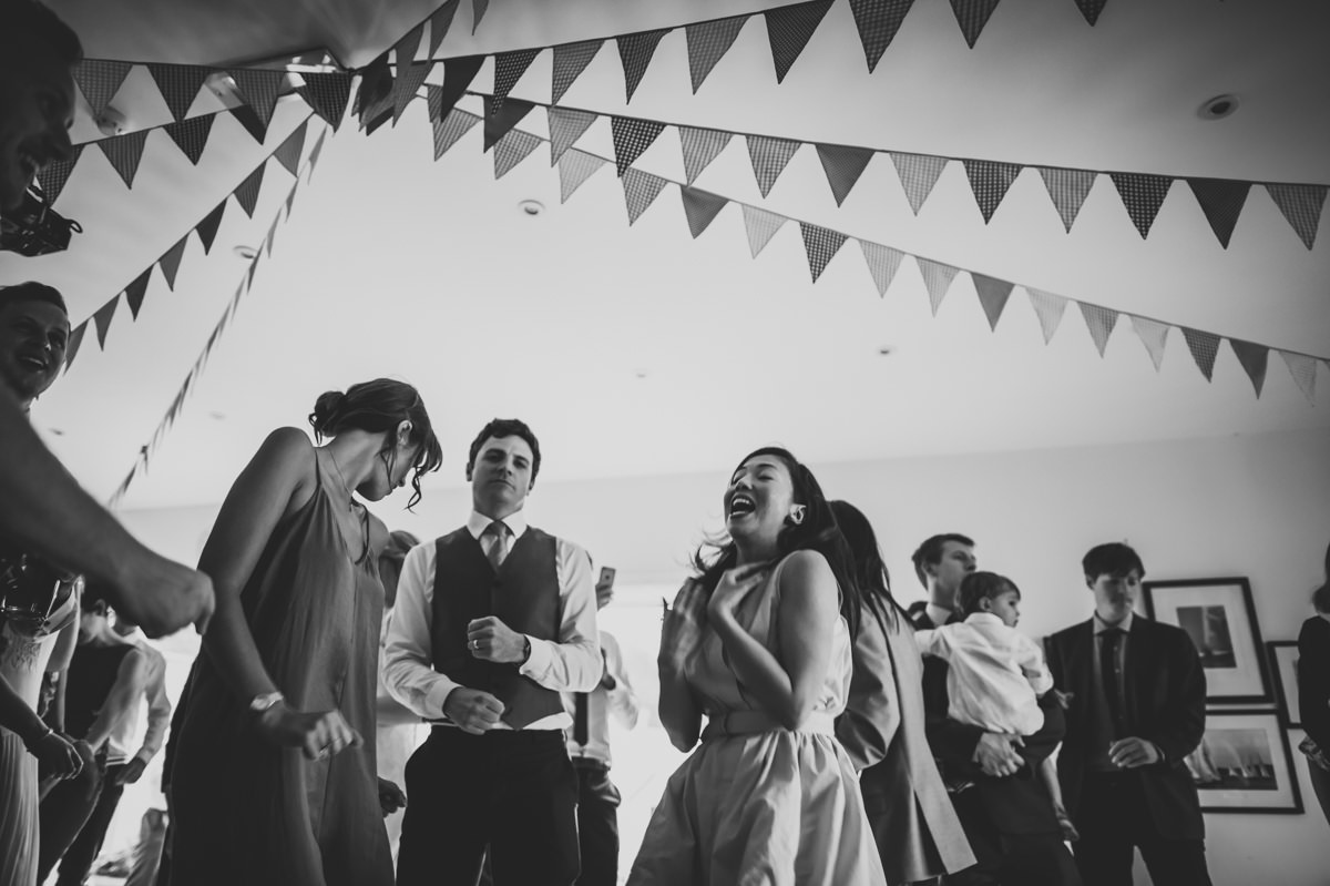 Guests dancing at a summer wedding in Sussex