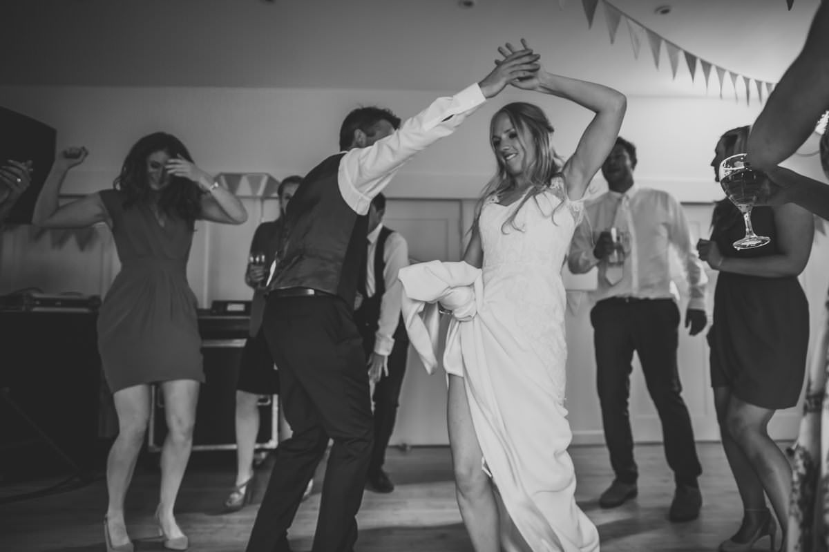 Bride and Groom dancing at their summer Sussex Wedding