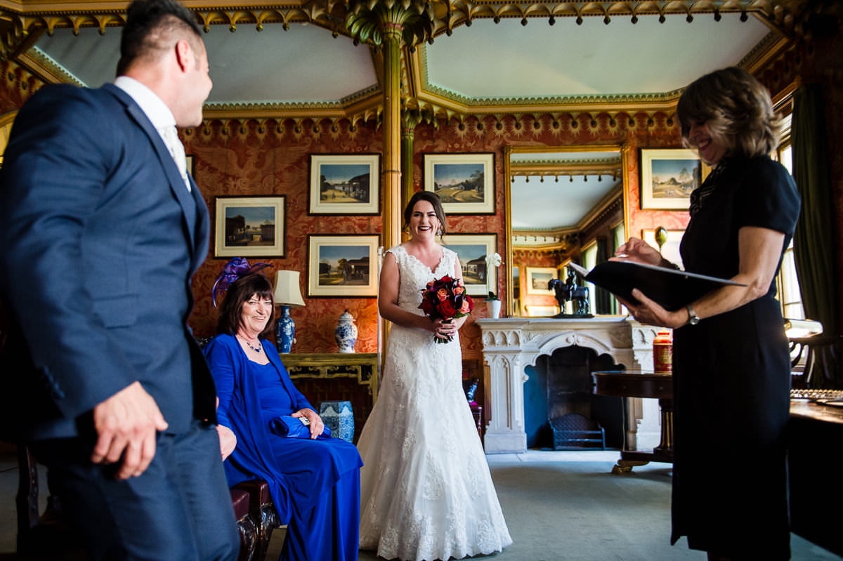 Bride enters the red drawing room with her flowers, to start the wedding ceremony