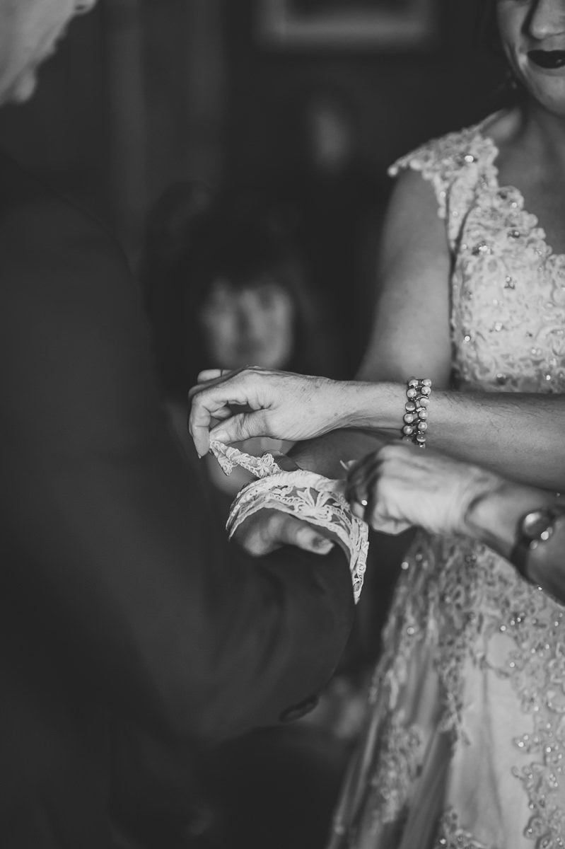 Bride and Groom's hands are hand-fasted with lace ribbon at their humanist wedding ceremony