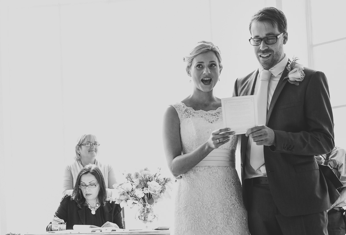 bride and groom singing at their wedding ceremony at additington palace
