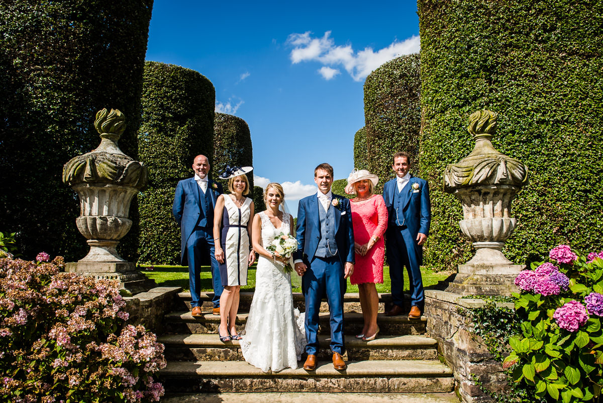 Bride & Groom with their families in the gardens of Arley Hall