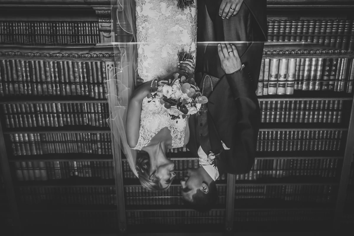 Reflection of Bride & Groom in the library at Arley Hall & Gardens wedding