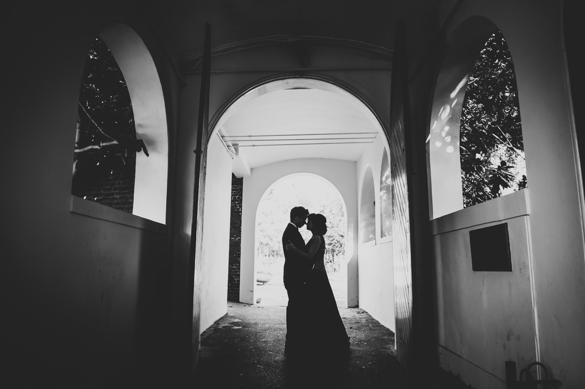 silhouette of a bride and groom kissing at the Orangery in Holland Park, London